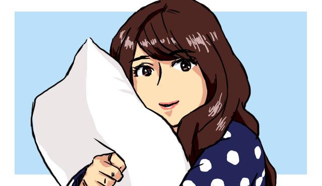 枕を抱く女
